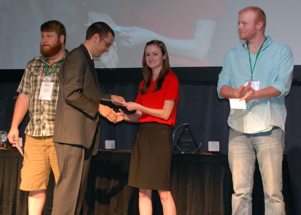 Branch member and officer Jenna Sanford receives the AGCO design award at AIM 2015 in New Orleans, LA.